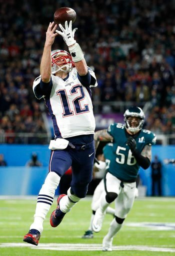 (AP Photo/Matt York). New England Patriots quarterback Tom Brady can't catch a pass on a flea flicker during the first half of the NFL Super Bowl 52 football game against the Philadelphia Eagles Sunday, Feb. 4, 2018, in Minneapolis.