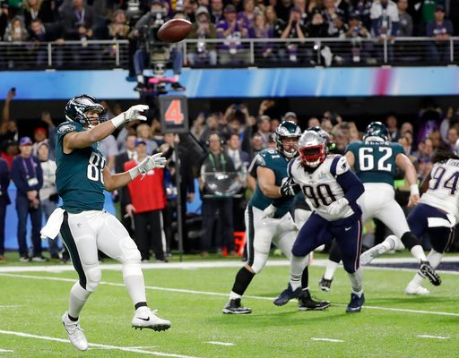 (AP Photo/Mark Humphrey). Philadelphia Eagles' Trey Burton, left, throws a touchdown pass to Nick Foles during the first half of the NFL Super Bowl 52 football game against the New England Patriots Sunday, Feb. 4, 2018, in Minneapolis.