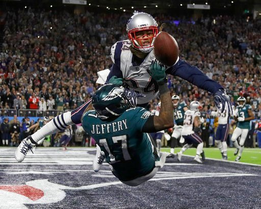 (AP Photo/Matt Slocum). New England Patriots' Stephon Gilmore, top, breaks up a pass intended for Philadelphia Eagles' Alshon Jeffery during the first half of the NFL Super Bowl 52 football game Sunday, Feb. 4, 2018, in Minneapolis.