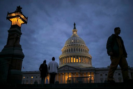 (AP Photo/J. Scott Applewhite, File). In this Jan. 21, 2018, file photo, lights illuminate the U.S. Capitol on second day of the federal shutdown as lawmakers negotiate behind closed doors in Washington. The era of trillion-dollar budget deficits is ab...