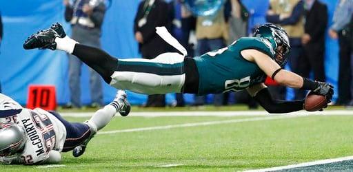 (AP Photo/Matt York). Philadelphia Eagles' Zach Ertz scores during the second half of the NFL Super Bowl 52 football game against the New England Patriots Sunday, Feb. 4, 2018, in Minneapolis.
