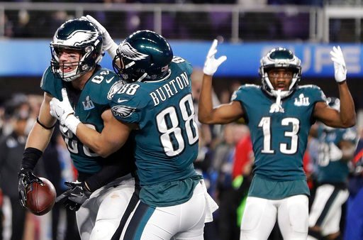 (AP Photo/Mark Humphrey). Philadelphia Eagles' Zach Ertz, left, celebrates his touchdown catch during the second half of the NFL Super Bowl 52 football game against the New England Patriots Sunday, Feb. 4, 2018, in Minneapolis.