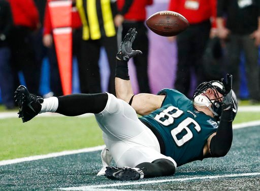 (AP Photo/Matt York). Philadelphia Eagles' Zach Ertz scores on a touchdown pass during the second half of the NFL Super Bowl 52 football game against the New England Patriots Sunday, Feb. 4, 2018, in Minneapolis.