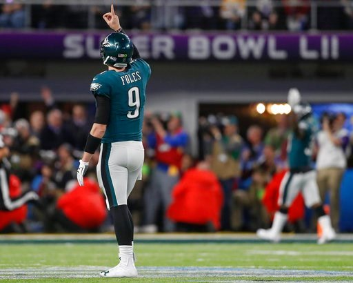 (AP Photo/Jeff Roberson). Philadelphia Eagles quarterback Nick Foles celebrates a touchdown pass to Zach Ertz during the second half of the NFL Super Bowl 52 football game against the New England Patriots Sunday, Feb. 4, 2018, in Minneapolis.