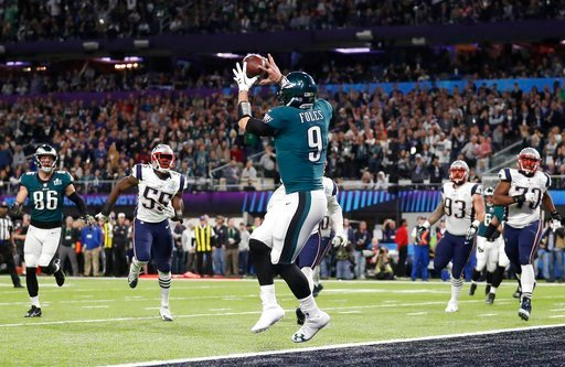 (AP Photo/Jeff Roberson). Philadelphia Eagles' Nick Foles catches a touchdown pass during the first half of the NFL Super Bowl 52 football game against the New England Patriots Sunday, Feb. 4, 2018, in Minneapolis.
