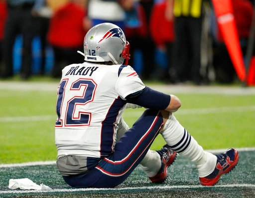 (AP Photo/Charlie Neibergall). New England Patriots' Tom Brady sits on the field after the NFL Super Bowl 52 football game against the Philadelphia Eagles Sunday, Feb. 4, 2018, in Minneapolis. The Eagles won 41-33.
