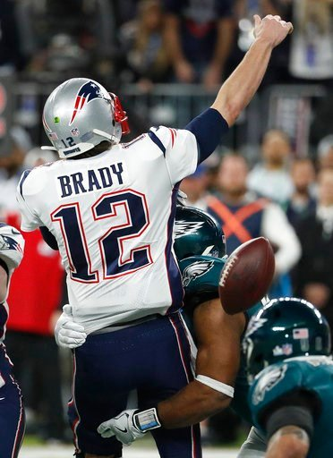 (AP Photo/Matt York). Philadelphia Eagles' Brandon Graham, center, strips the ball from New England Patriots quarterback Tom Brady during the second half of the NFL Super Bowl 52 football game Sunday, Feb. 4, 2018, in Minneapolis. The Eagles recovered ...