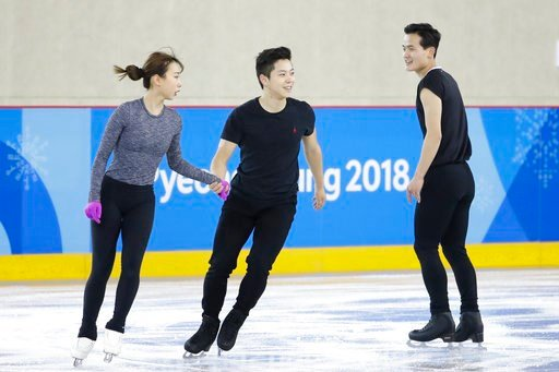 (AP Photo/Felipe Dana). North Korea's Kim Ju Sik, right, skates next to South Korea's Kim Kyueun, left, and Kam Alex Kang Chan during a Pairs Figure Skating training session prior to the 2018 Winter Olympics in Gangneung, South Korea, Monday, Feb. 5, 2...