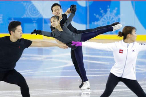 (AP Photo/Felipe Dana). North Korea's Ryom Tae Ok and Kim Ju Sik, center, practice next to South Korea's Kim Kyueun, front right, and Kam Alex Kang Chan during a Pairs Figure Skating training session prior to the 2018 Winter Olympics in Gangneung, Sout...