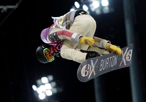 (AP Photo/Sergei Grits). FILE - In this Feb. 10, 2014, file photo, Shaun White, of the United States, gets air during a snowboard halfpipe training session at the Rosa Khutor Extreme Park at the 2014 Winter Olympics in Krasnaya Polyana, Russia. White s...