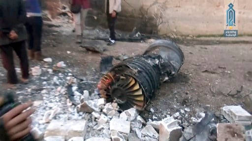 (Ibaa News Agency via AP). This photo provided by the Ibaa News Agency the media arm of al-Qaida's branch in Syria shows part of a Russian plane that was shot down by rebel fighters over northwest Idlib province in Syria, Saturday, Feb. 3, 2018.  A Rus...