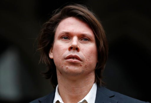 (AP Photo/Kirsty Wigglesworth). Lauri Love, who is accused of hacking into U.S. government computers, poses for the media outside The Royal Courts of Justice in London, Monday, Feb. 5, 2018. The ruling in Lauri Love's appeal against extradition to the ...