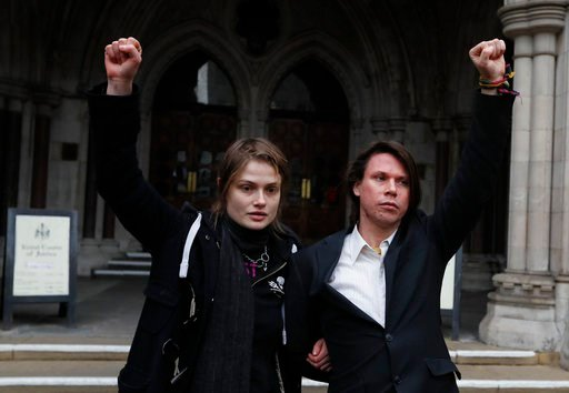 (AP Photo/Kirsty Wigglesworth). Lauri Love and his girlfriend Sylvia Mann pose for the media outside The Royal Courts of Justice in London, Monday, Feb. 5, 2018. The ruling in Lauri Love's appeal against extradition to the United States, where he faces...