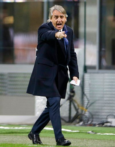 (AP Photo/Antonio Calanni). FILE - In this March 12, 2016 file photo, Inter Milan coach Roberto Mancini shouts instructions during the Serie A soccer match between Inter Milan and Bologna at the San Siro stadium in Milan, Italy. The Italian soccer fede...
