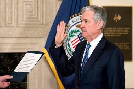 (AP Photo/Andrew Harnik). Jerome Powell takes the oath of office as the new chairman of the Federal Reserve, Monday, Feb. 5, 2018, in Washington.