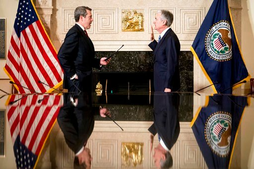 (AP Photo/Andrew Harnik). Jerome Powell, right, takes the oath of office as Federal Reserve Board chair at the Federal Reserve, Monday, Feb. 5, 2018, in Washington. Powell is sworn in by Federal Reserve Board Member Vice Chairman for Supervision, Randa...