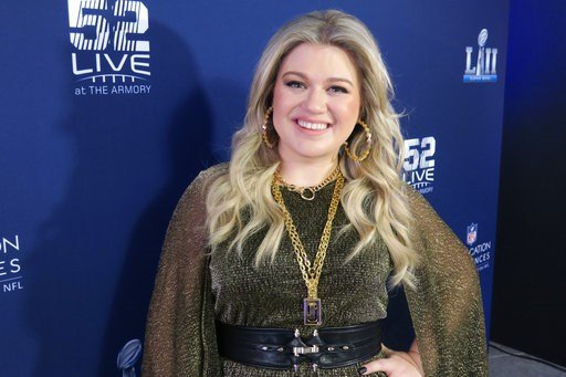 (AP Photo/John Carucci). Kelly Clarkson appears at Nomadic Live at The Armory prior to the Super Bowl on Sunday, Feb. 4, 2018 in Minneapolis. Clarkson said she's not worried about Pink nailing the national anthem at the Super Bowl despite having the fl...