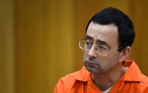 (Matthew Dae Smith/Lansing State Journal via AP). Larry Nassar listens as Rachael Denhollander gives her victim impact statement Friday, Feb. 2, 2018, in Eaton County Circuit Court, the second and final day of victim impact statements in Judge Janet Cu...