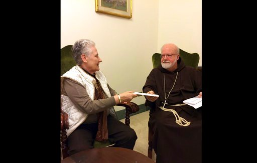 (Catherine Bonnet via AP). Marie Collins, a member of the pope's sex-abuse commission, hands a letter to Cardinal Sean O'Malley detailing the abuse of Juan Carlos Cruz and a cover-up by Chilean church authorities, at the Domus Santa Marta on April 12, ...
