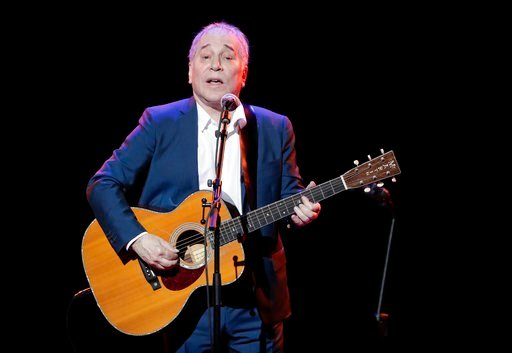 (AP Photo/Julie Jacobson, File). FILE - In a Sept. 22, 2016 file photo, musician Paul Simon performs during the Global Citizen Festival, in New York. On Monday, Feb. 5, 2018, Simon took to social media to say his upcoming tour will be his last, citing ...