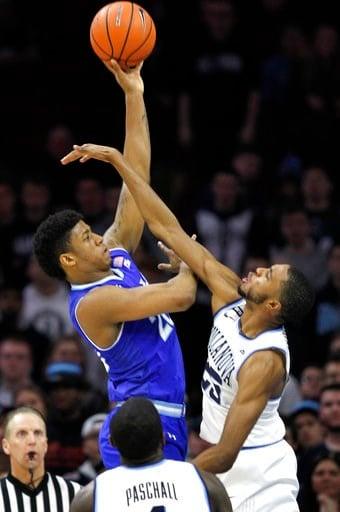(AP Photo/Laurence Kesterson). Seton Hall forward Desi Rodriguez (20) shoots over Villanova guard Mikal Bridges (25) during the second half of an NCAA college basketball game, Sunday, Feb. 4, 2018, in Philadelphia, Pa.