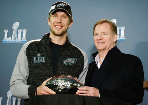 (AP Photo/Chris Carlson). NFL commissioner Roger Goodell and Philadelphia Eagles quarterback Nick Foles poses with his MVP trophy during a news conference after the NFL Super Bowl 52 football game Monday, Feb. 5, 2018, Bloomington, Minn. The Eagles won...
