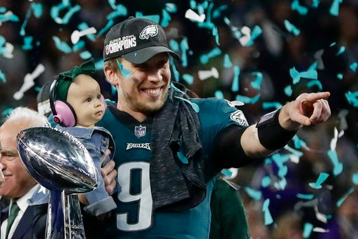 (AP Photo/Frank Franklin II). Philadelphia Eagles' Nick Foles holds his daughter, Lily, after beating the New England Patriots in the NFL Super Bowl 52 football game Sunday, Feb. 4, 2018, in Minneapolis.