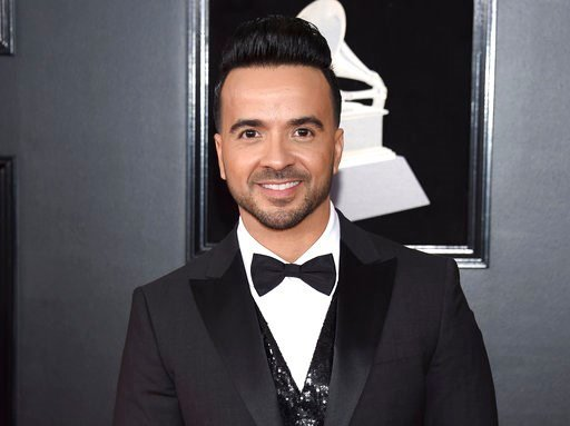 "(Photo by Evan Agostini/Invision/AP, File). FILe - In this Jan. 28, 2018 file photo, Luis Fonsi arrives at the 60th annual Grammy Awards in New York. The annual BMI Latin Awards will honor Fonsi not only for his mega smash ""Despacito"" but for the strin..."