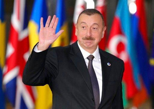 (AP Photo/Olivier Matthys, File). FILE- In this file photo taken on Friday, Nov. 24, 2017, Azerbaijan's President Ilham Aliyev waves as he arrives for an Eastern Partnership Summit in Brussels. Ilham Aliyev, who has ruled the oil-rich Caspian Sea natio...