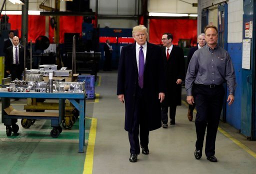 (AP Photo/Evan Vucci). President Donald Trump participates in a tour of Sheffer Corporation with company president and CEO Jeff Norris, right, to promote his tax policy, Monday, Feb. 5, 2018, in Cincinnati. Treasury Secretary Steven Mnuchin and Sen. Ro...