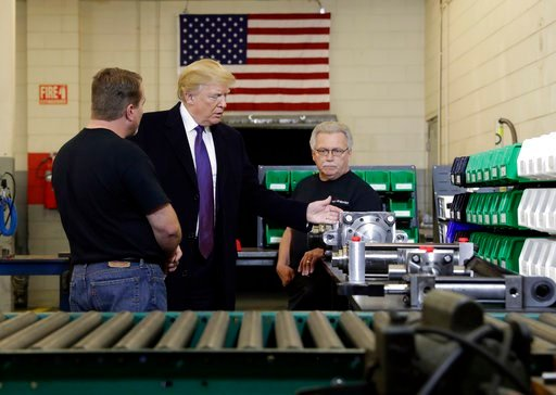 (AP Photo/Evan Vucci). President Donald Trump participates in a tour of Sheffer Corporation to promote his tax policy, Monday, Feb. 5, 2018, in Blue Ash, Ohio.