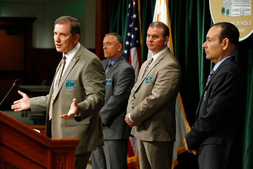(AP Photo/Damian Dovarganes). Los Angeles County Sheriff's Department Homicide Bureau Lt. John Corina, far left, discusses the most recent details of the Natalie Wood death investigation at a news conference in Los Angeles, Monday, Feb. 5, 2018. Offici...