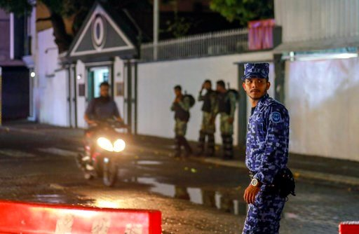 (AP Photo/Mohamed Sharuhaan). Maldives defence soldiers and policemen guard the main street after government declared a 15-day state of emergency in Male, Maldives, early Tuesday, Feb. 6, 2018. The Maldives government declared a 15-day state of emergen...