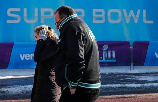 (AP Photo/Jeff Roberson, file). FILE - In this Feb. 4, 2018 file photo fans brave cold temperatures as they make their way to U.S. Bank Stadium for the NFL Super Bowl 52 football game between the Philadelphia Eagles and the New England Patriots in Minn...