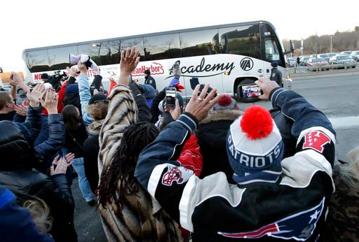 (AP Photo/Steven Senne). Fans wave as a bus carrying New England Patriots NFL football players and staff arrives at Gillette Stadium, in Foxborough, Mass., Monday, Feb. 5, 2018, after the team's loss to the Philadelphia Eagles in the NFL Super Bowl in ...