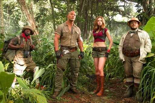 "(Frank Masi/Sony Pictures via AP, File). FILE - This file image released by Sony Pictures shows Kevin Hart, from left, Dwayne Johnson, Karen Gillan and Jack Black in ""Jumanji: Welcome to the Jungle."" According to studio estimates Sunday, ""Jumanji"" gros..."