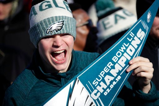 (AP Photo/Julio Cortez). A Philadelphia Eagles fan chants while waiting for the team to arrive at Philadelphia International Airport a day after defeating the New England Patriots in Super Bowl 52 in Minneapolis, Monday, Feb. 5, 2018.