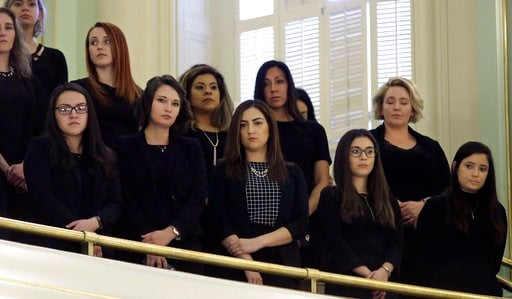 (AP Photo/Rich Pedroncelli). Women, dressed in black, stand in the Assembly gallery to show their support for measure to give whistleblower protection for legislative staff members, Monday, Feb. 5, 2018, in Sacramento, Calif. The bill, AB403, by Assemb...
