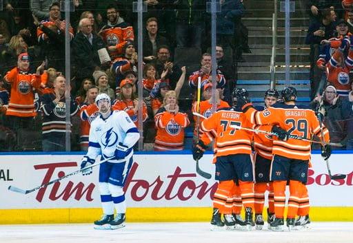 (Jason Franson/The Canadian Press via AP). Tampa Bay Lightning' Anton Stralman (6) looks on as the Edmonton Oilers celebrate a goal during first period NHL action in Edmonton, Alberta, Monday, Feb. 5, 2018.
