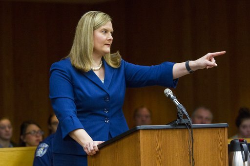 (Cory Morse /The Grand Rapids Press via AP). Michigan Assistant Attorney General Angela Povilaitis points at Larry Nassar while giving her closing statement during Nassar's sentencing at Eaton County Circuit Court in Charlotte, Mich.,  Monday, Feb. 5, ...