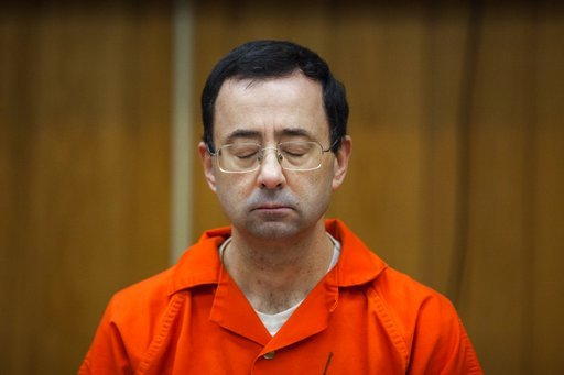 (Cory Morse /The Grand Rapids Press via AP). Larry Nassar listens during his sentencing at Eaton County Circuit Court in Charlotte, Mich.,  Monday, Feb. 5, 2018. The former Michigan State University sports-medicine and USA Gymnastics doctor received 40...