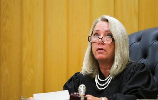 (Matthew Dae Smith/Lansing State Journal via AP). Eaton County Circuit Judge Janice Cunningham delivers her sentence Monday, Feb. 5, 2018, on the third and final day of sentencing in Eaton County Court in Charlotte, Mich.. She sentenced Larry Nassar to...