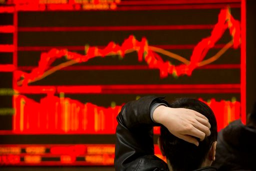 (AP Photo/Mark Schiefelbein). An investor monitors stock prices at a brokerage house in Beijing, Tuesday, Feb. 6, 2018. Shares tumbled in Asia on Tuesday after a wild day for U.S. markets that resulted in the biggest drop in the Dow Jones industrial av...