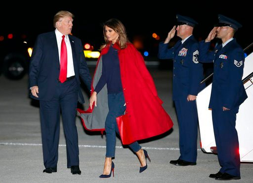 (AP Photo/Carolyn Kaster). President Donald Trump and first lady Melania Trump arrive on Air Force One at Palm Beach International Airport, in West Palm Beach, Fla., Friday, Feb. 2, 2018.