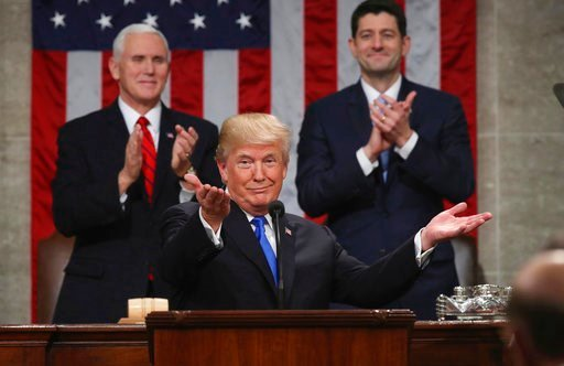 (Win McNamee/Pool via AP, File). FILE - In this Jan. 30, 2018, file photo, President Donald Trump gestures as delivers his first State of the Union address in the House chamber of the U.S. Capitol to a joint session of Congress in Washington, as Vice P...