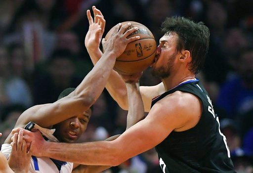 (AP Photo/Mark J. Terrill). Dallas Mavericks guard Dennis Smith Jr., left, hits Los Angeles Clippers forward Danilo Gallinari, of Italy, in the face with the ball as he tries to pass during the second half of an NBA basketball game, Monday, Feb. 5, 201...