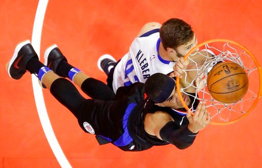 (AP Photo/Mark J. Terrill). Los Angeles Clippers forward Tobias Harris, below, dunks as Dallas Mavericks forward Maximilian Kleber, of Germany, defends during the first half of an NBA basketball game, Monday, Feb. 5, 2018, in Los Angeles.