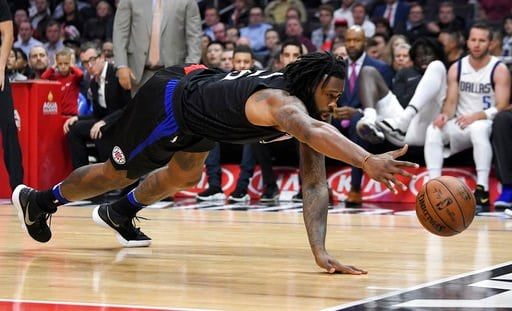 (AP Photo/Mark J. Terrill). Los Angeles Clippers center DeAndre Jordan dives for a loose ball during the first half of an NBA basketball game against the Dallas Mavericks, Monday, Feb. 5, 2018, in Los Angeles.
