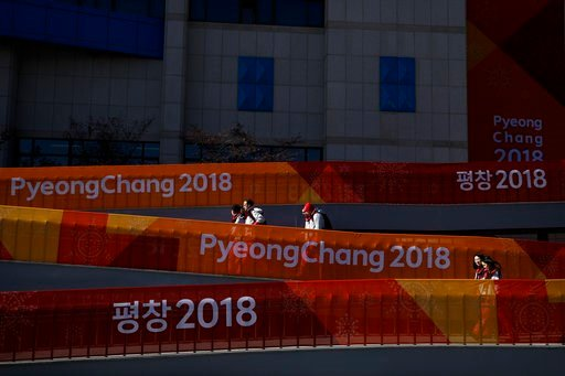 (AP Photo/Jae C. Hong). People walk up the ramp outside the Gangneung Curling Center at the Olympic Park ahead of the 2018 Winter Olympics in Gangneung, South Korea, Tuesday, Feb. 6, 2018.