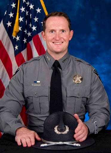 (El Paso County Sheriff's Office via AP). In this undated photo provided on Monday, Feb. 5, 2018, by the El Paso County Sheriff's Office, Deputy Micah Flick is shown. Flick was shot and killed on Monday, while investigating a stolen vehicle in Colorado...